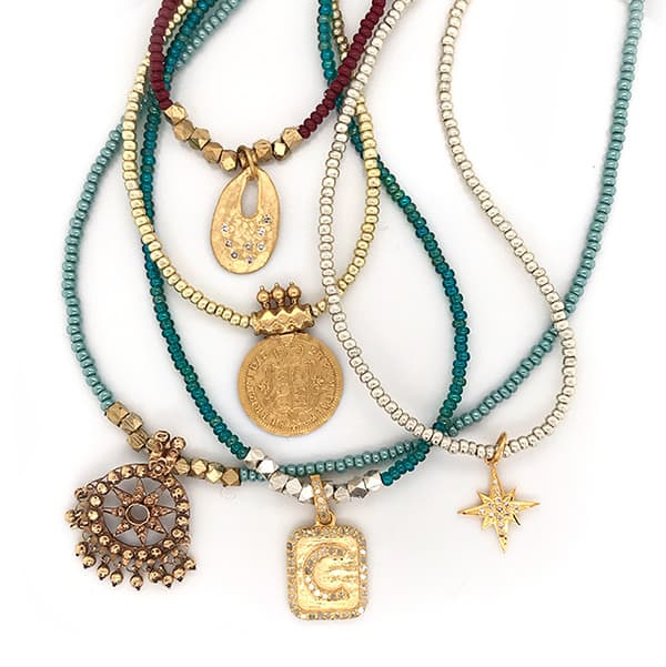 Mix of Beads and stones beautifully crafted necklace set with a series of beautiful charms